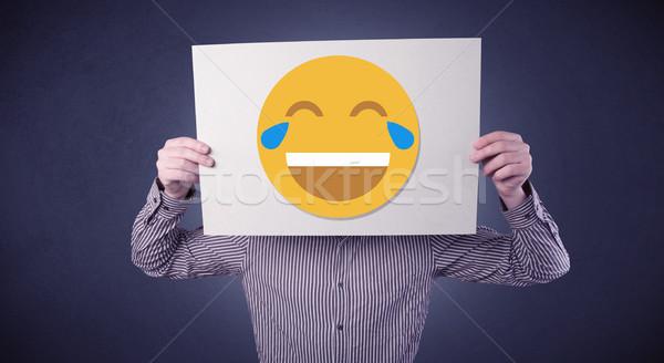 Zakenman papier lachend emoticon jonge Stockfoto © ra2studio
