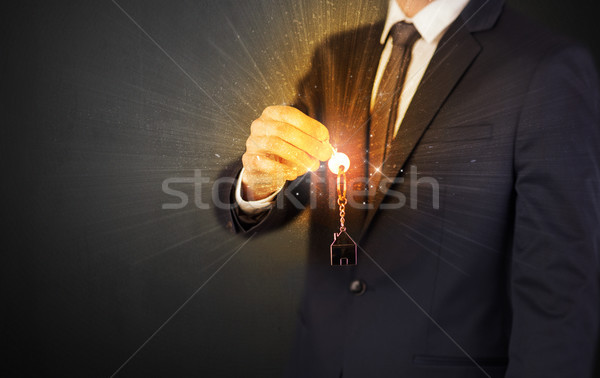Man in suit hand over keys Stock photo © ra2studio