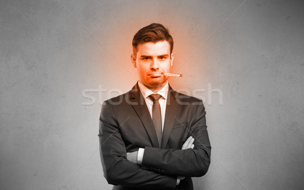 Sick businessman with burning red head concept Stock photo © ra2studio