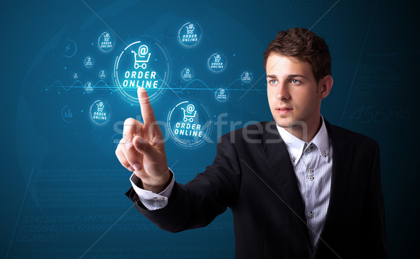 Businessman pressing promotion and shipping type of modern buttons Stock photo © ra2studio