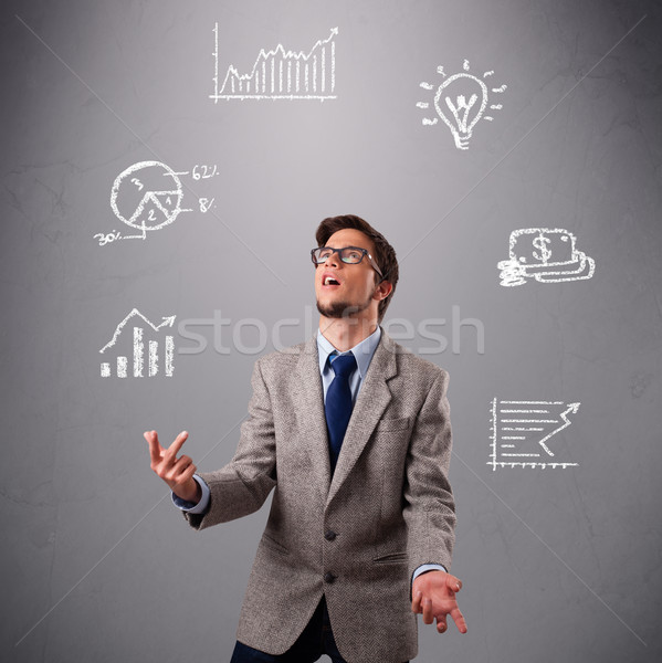 Stock photo: young boy juggling with statistics and graphs
