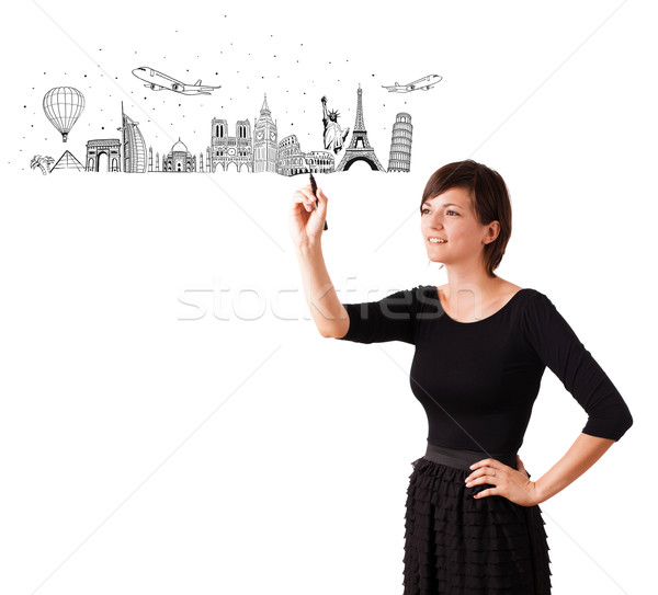 Young woman drawing famous cities and landmarks on whiteboard  Stock photo © ra2studio