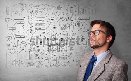 Atrakcyjny człowiek patrząc giełdzie wykresy symbolika Zdjęcia stock © ra2studio