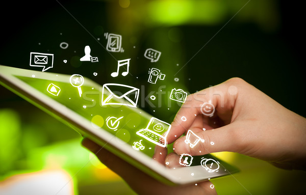 Finger pointing on tablet pc, social media concept Stock photo © ra2studio