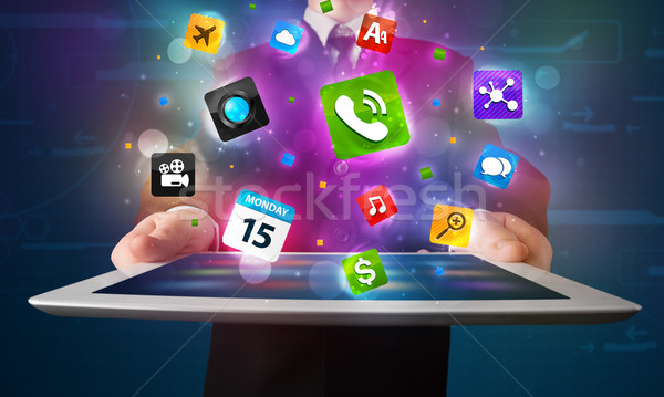 Stockfoto: Jonge · zakenman · tablet · moderne · kleurrijk