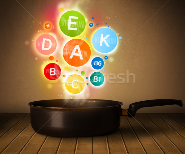Colorful vitamins coming out from cooking pot Stock photo © ra2studio