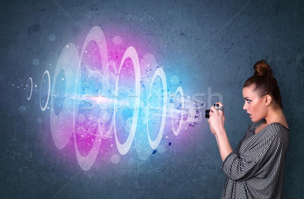 Stock photo: Photographer girl making photos with powerful light beam