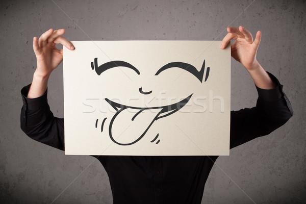 üzletember tart papír vicces mosolygós arc fiatal Stock fotó © ra2studio