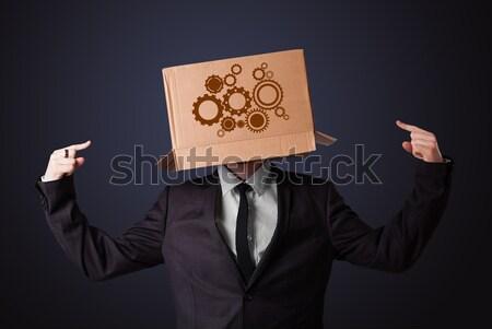 Fiatalember gesztikulál kartondoboz fej áll arc Stock fotó © ra2studio