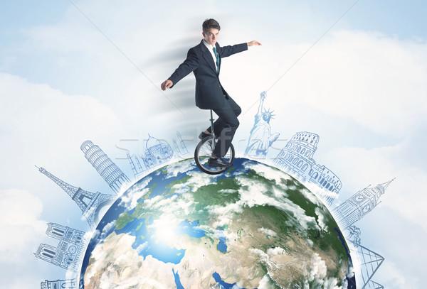 男 ライディング 一輪車 周りに 世界中 都市 ストックフォト © ra2studio