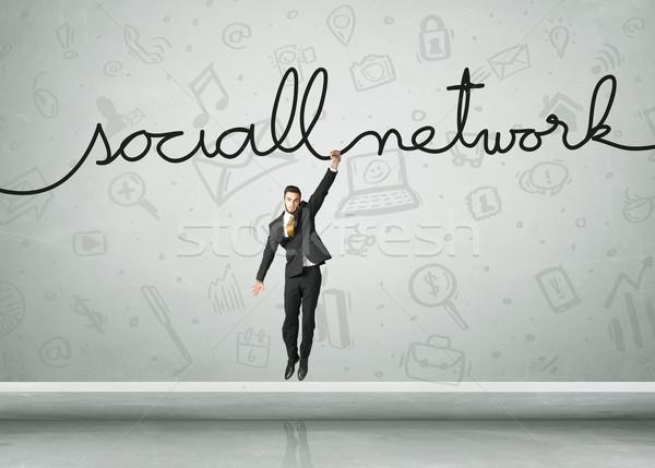 Opknoping zakenman touw hand ontwerp Stockfoto © ra2studio