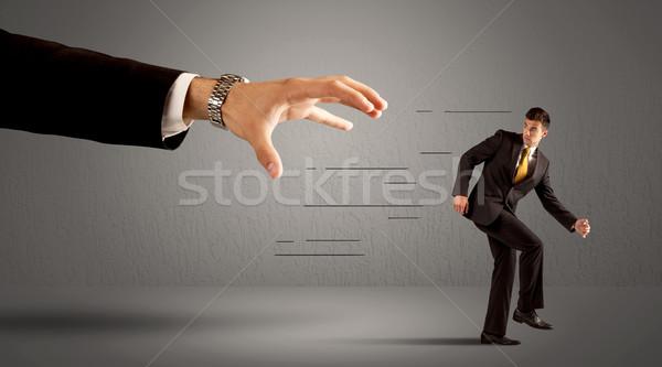 üzletember fut messze hatalmas kéz öltöny Stock fotó © ra2studio
