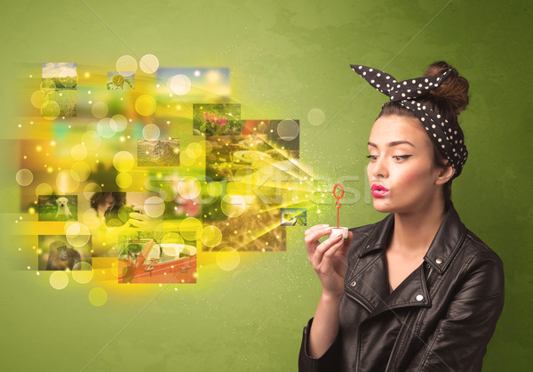 Cute girl blowing colourful glowing memory picture concept Stock photo © ra2studio