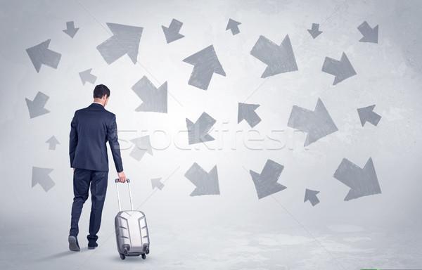 Businessman leaving with pell-mell arrows around Stock photo © ra2studio