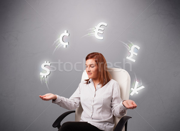 young lady sitting and juggling with currency icons Stock photo © ra2studio