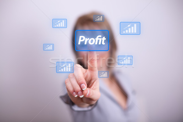Woman pressing modern profit button with one hand Stock photo © ra2studio