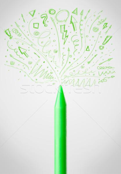 Crayon close-up with sketchy arrows Stock photo © ra2studio