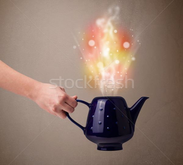 Tea pot with abstract steam and colorful lights Stock photo © ra2studio