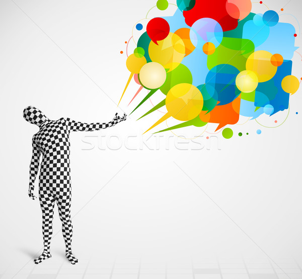 Strange guy in morphsuit looking at colorful speech bubbles Stock photo © ra2studio