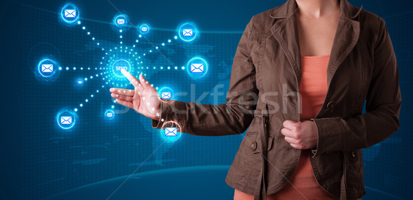 Woman pressing virtual messaging type of icons Stock photo © ra2studio