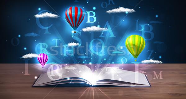 Livre ouvert Fantasy résumé nuages ballons Photo stock © ra2studio