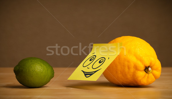 Stock photo: Lemon with post-it note looking at lime