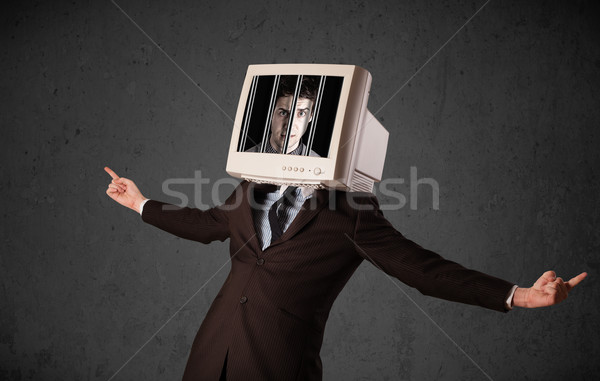 Stock photo: Business man with monitor on his head traped into a digital syst