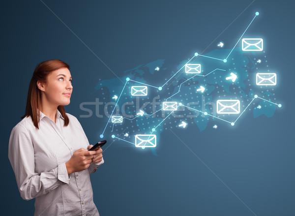 Fiatal hölgy tart telefon nyilak üzenet Stock fotó © ra2studio