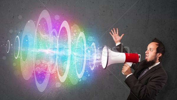 Homem alto-falante colorido energia viga fora Foto stock © ra2studio