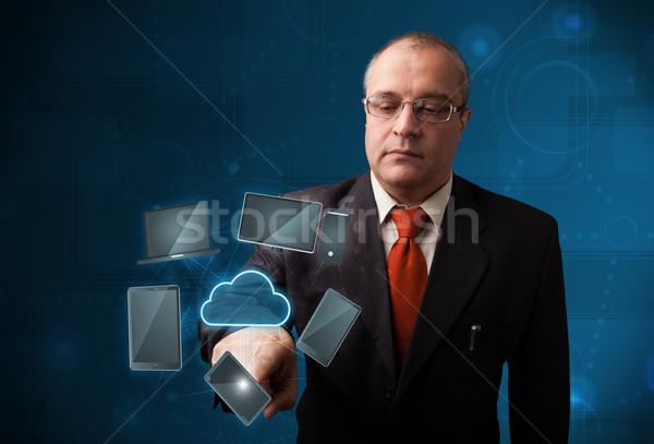 Imprenditore toccare alta tecnologia nube servizio piedi Foto d'archivio © ra2studio