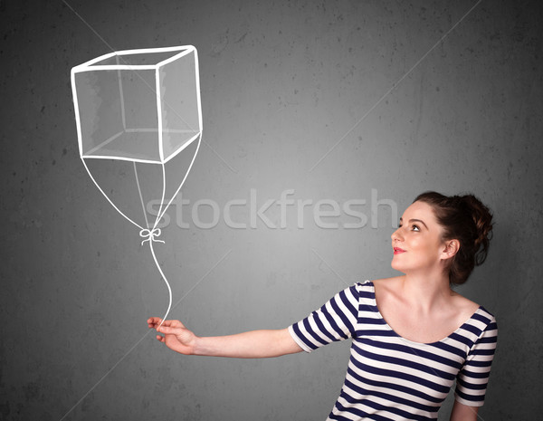 Woman holding a cube balloon Stock photo © ra2studio