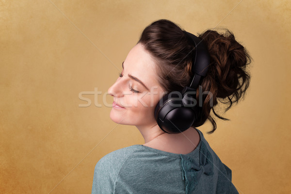 Stock photo: Young woman with headphones listening to music with copy space