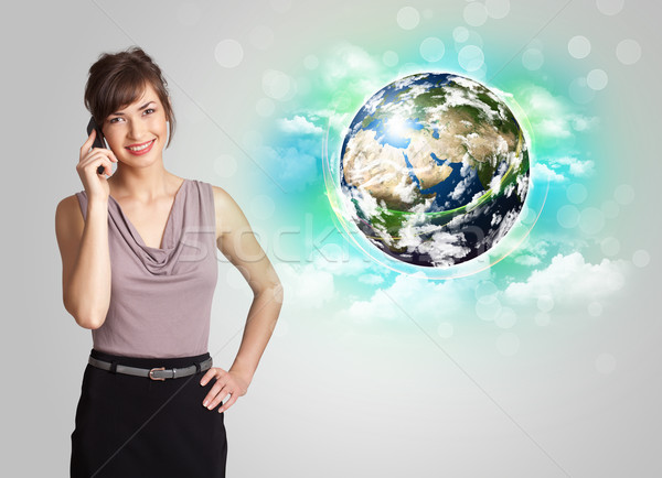 Młoda kobieta ziemi Chmura młodych business woman działalności Zdjęcia stock © ra2studio