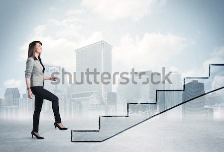 Stock photo: Energetic business man jumping over a bridge with gap