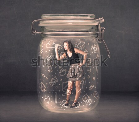 Business woman captured in glass jar with hand drawn media icons Stock photo © ra2studio