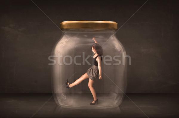 Businesswoman captured in a glass jar concept Stock photo © ra2studio
