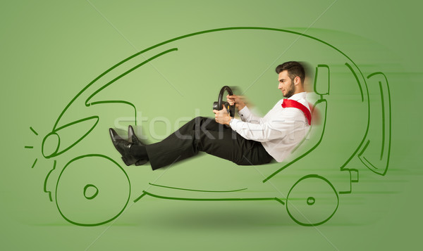 Stock photo: Man drives an eco friendy electric hand drawn car