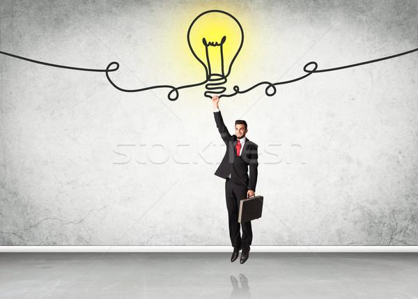 Stockfoto: Opknoping · zakenman · idee · lamp · hand · helpen