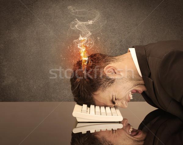 Triste negócio pessoas cabeça fogo frustrado Foto stock © ra2studio