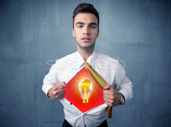 Businessman ripping off shirt and idea light bulb appears  Stock photo © ra2studio