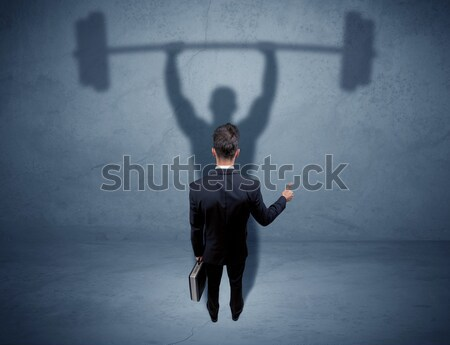 Zakenman gewichtheffen schaduw jonge elegante verkoper Stockfoto © ra2studio