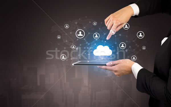 Cloud and connectivity concept on a tablet Stock photo © ra2studio