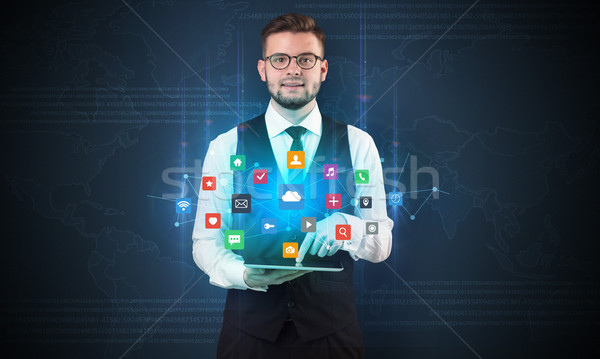 Young businessman with tablet and application Stock photo © ra2studio