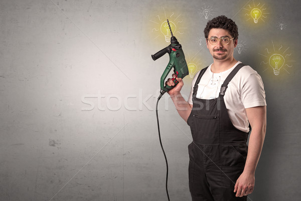 Stock photo: Craftsman standing with instrument.
