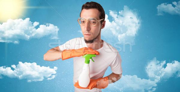Sereno governante arancione guanti nuvoloso maschio Foto d'archivio © ra2studio