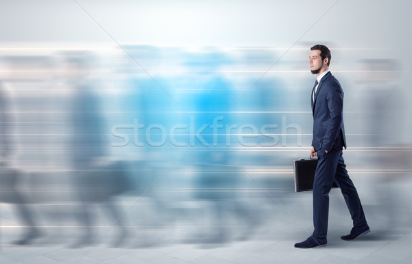 Businessman walking on a crowded street Stock photo © ra2studio