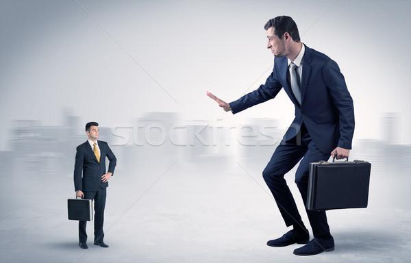 Gigant biznesmen przestraszony mały poważny działalności Zdjęcia stock © ra2studio