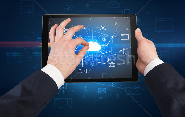 First person view of tablet with cloud office concept Stock photo © ra2studio