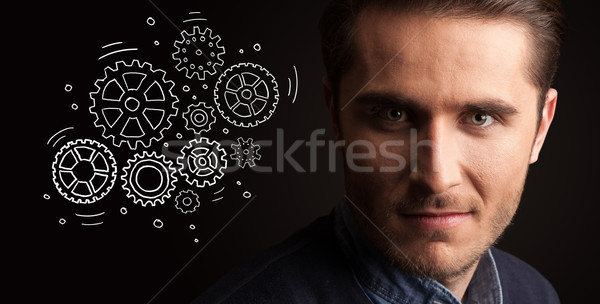 Portrait of a young businessman on dark background Stock photo © ra2studio