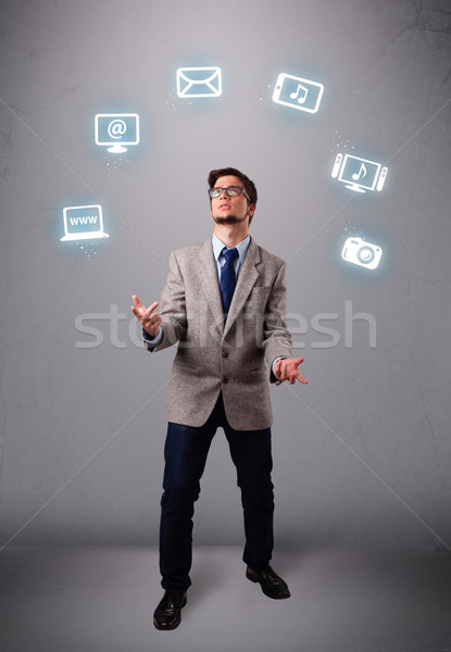 funny boy juggling with electronic devices icons Stock photo © ra2studio